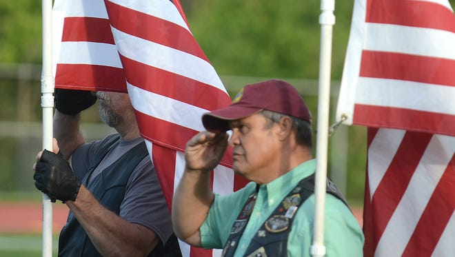 A pair of veterans salute the American Flag during the Sept. 1 dedication ceremony.
