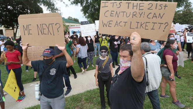 Peaceful protesters march in Palm Coast protesting the death of George Floyd, Wednesday June 3, 2020.