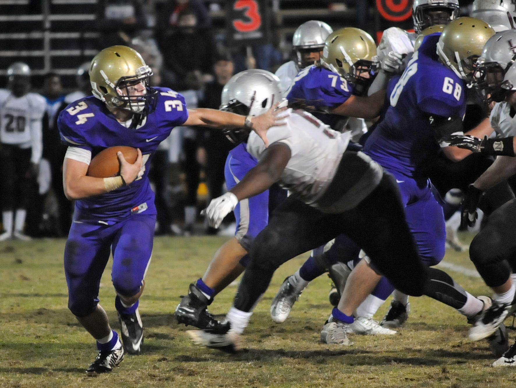 CPA's James Deaton looks to get by Liberty Magnet defenders in the fourth quarter of CPA's 21-0 3A semifinal win.