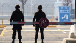 South Korean military policemen stand guard at the