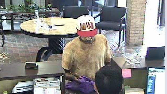 Police are seeking two suspects in an bank robbery Monday afternoon on Johnston Street.