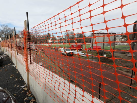 A new retaining wall is being installed at the athletic