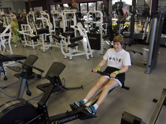 Margrit Kroner works out at Anytime Fitness on Wednesday in Fort Myers.