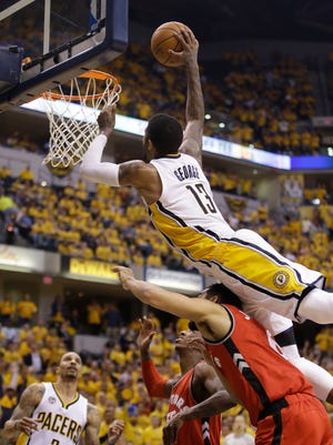 Paul George (13) has soared in the series against the Toronto Raptors: He is averaging 27.5 points, 6.8 rebounds and 4.8 assists. Friday, he went up for  a dunk over Toronto Raptors' Cory Joseph during the second half of Game 6.