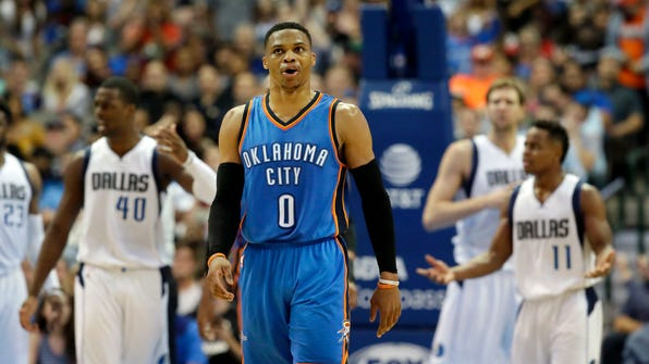 Oklahoma City Thunder guard Russell Westbrook (0) walks up courts away from Dallas Mavericks players after getting the call from referees during the second half of an NBA basketball game in Dallas, Monday, March 27, 2017. The Thunder won 92-91. (AP Photo/LM Otero)