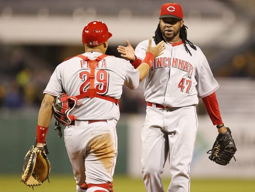 Cincinnati Reds catcher Brayan Pena (29) celebrates with starting pitcher Johnny Cueto (47) after defeating the Pittsburgh Pirates 4-1 at PNC Park.