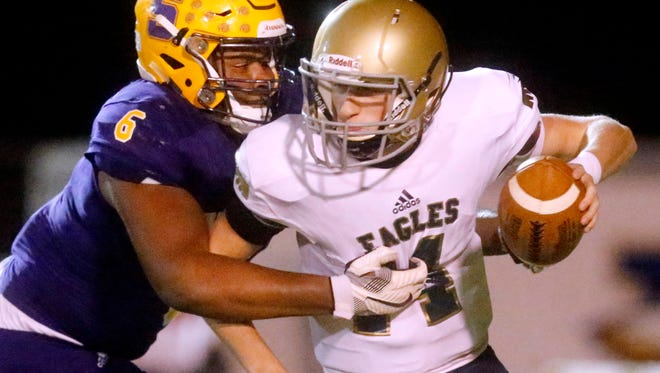 Smyrna's Dallas Walker records a sack during a 2017 playoff game against Independence. Walker's college interest has increased significantly since May.
