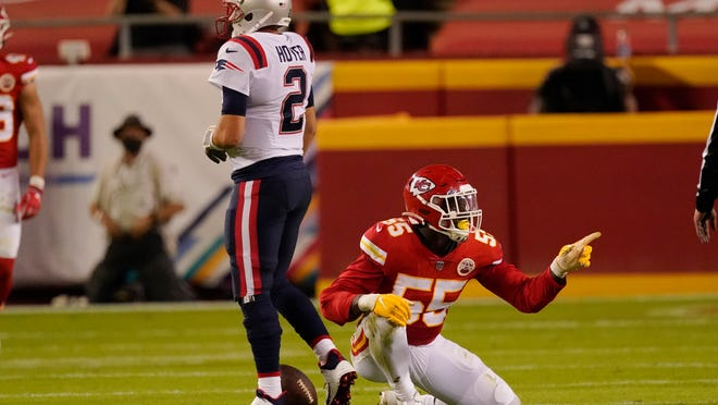 Kansas City Chiefs defensive end Frank Clark (55) celebrates after sacking New England Patriots quarterback Brian Hoyer (2) during the first half of an NFL football game, Monday, Oct. 5, 2020, in Kansas City.