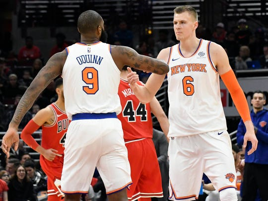 New York Knicks forward Kristaps Porzingis (6) is greeted by center Kyle O'Quinn (9) after making a three-point basket against the Chicago Bulls during the first quarter at United Center on Wednesday, Dec. 27, 2017.