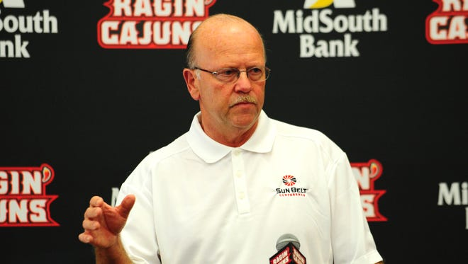 Sun Belt Conference commissioner Karl Benson addresses members of the media during UL football Media Day in 2013.