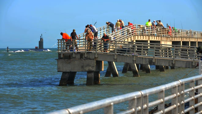 A U.S. Navy nuclear submarine goes out of Port Canaveral Tuesday giving people on the fishing pier a great view. The fishing pier at Jetty Park has reopened Saturday after being closed from damage from Hurricane Matthew. The pier appears to have new railings and new electrical work.