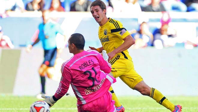 Crew midfielder Ethan Finlay watches his shot beat Red Bules keeper Luis Robles to give the Crew a 2-0 first half lead.