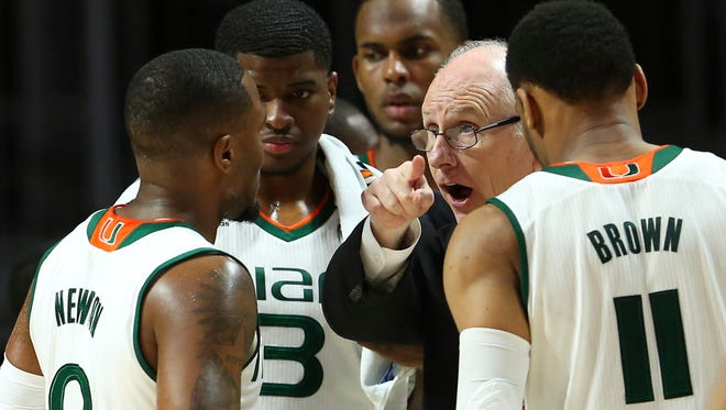 Miami basketball coach Jim Larranaga gives instructions to his team against Duke in Coral Gables, Fla., on Feb. 25, 2017.
