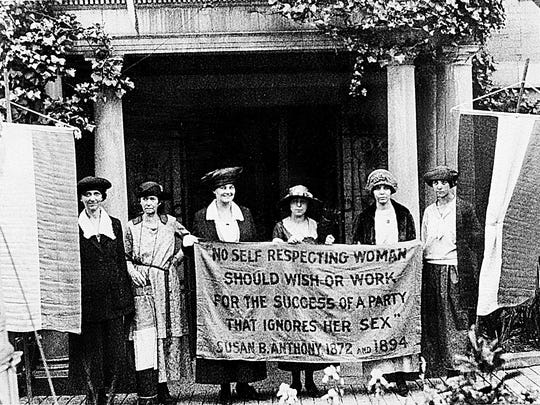 Suffragettes march for the ratification of the 19th Amendment granting women the right to vote at the Republican National Convention in Chicago in June 1920. Chief organizer and author of the Equal Rights Amendment Alice Paul stands second from right.