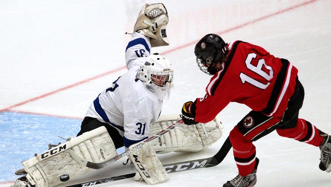 Waukesha's Garrett Larsen (31) is among the state leaders in save percentage and goals-against average.
