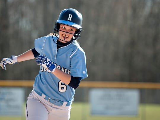 Richmond's Alana Schroeder smiles and rounds third after hitting a home run during a softball game Tuesday, April 28, 2015 at Richmond High School.