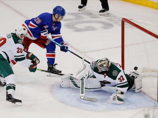 New York Rangers' Chris Kreider (20) shoots the puck past Minnesota Wild goaltender Alex Stalock (32) for a goal during the third period of an NHL hockey game Monday, Nov. 25, 2019, in New York. (AP Photo/Frank Franklin II)