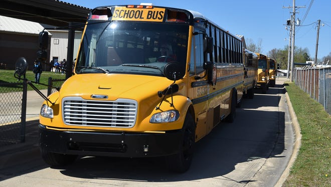 Buses line up behind Pinkston Middle School on Monday afternoon. Pinkston was one of two area school campuses to have recently been awarded an A grade for the 2016-17 school year by the Arkansas Department of Education. The Norfork High School was the other area campus to receive an A grade.
