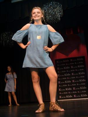 Alyssa Leukroth, front, of Gulf Coast High School, and Courtney Mai, also of Gulf Coast High, model fashions from Francesca.