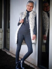Pat Goodman wears an Arctic leopard faux-fur vest from Fabulous Furs; grey turtleneck by 212 Collections; grey tights from Victoria's Secret; and Dirty Laundry short silver boots from Famous Footwear.
