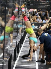 Lauren Brooks of Cape Coral completes a strict handstand push-up during the CrossFit Southeast regionals in Jacksonville on Saturday.