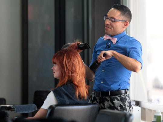 Danny Fierro works on co-woker Lindsey Hatcher's hair at Brien O'Brien Salon in Palm Springs on May 19, 2016. Fierro, 37, a Palm Springs hairdresser, will take part in the AIDS/LifeCycle bicycle ride from San Francisco to Los Angeles.