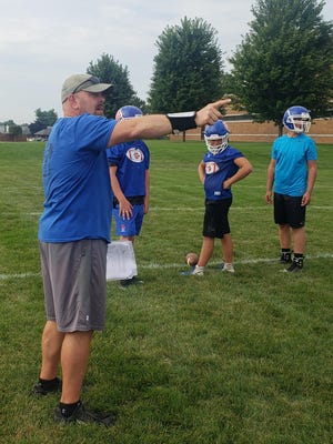 Lenawee Christian head coach Bill Wilharms instructs players during the first day of practice on Monday.