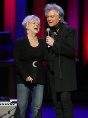 Connie Smith and husband Marty Stuart share a laugh on stage at the Grand Ole Opry Saturday.