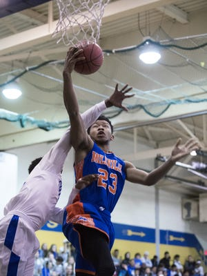 Millville's Jordan Fitchett (23) drives to the basket against Buena Friday, Dec. 16 at Buena Regional High School in Buena.