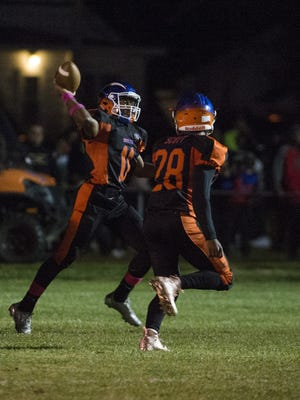 Millville quarterback Elijah Nichols (11) launches a pass in a game against Hammonton Friday, Oct. 13, 2017 in Millville.