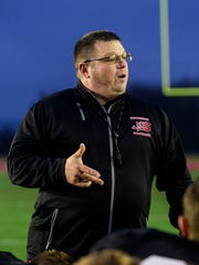 Southridge Head Coach Scott Buening talks to his team about their upcoming semi-state battle against the No.2 Indianapolis Scecina at the end of an evening practice at Southridge High School in Huntingburg, Ind., Wednesday, Nov. 15, 2017. The Class 2A semi-state game will be held on Saturday at 1 p.m. CST at Indianapolis Tech.