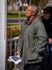 A march organizer, Malaika Mitchell, addresses the