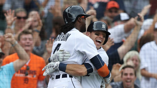 Detroit Tigers' Ian Kinsler celebrates with Cameron Maybin, who scored on a wild pitch by the Seattle Mariners' Steve Cishek during tenth inning action Thursday, June 23, 2016 at Comerica Park in Detroit.