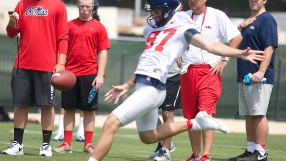 Gary Wunderlich works on his punts in practice. Wunderlich will kick field goals for Ole Miss this Saturday.