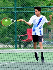 Max Yuan of Seven Hills returns service in doubles