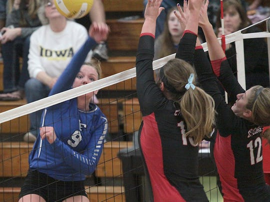 Bondurant-Farrar's Jessica Noonan sends the ball back during Tuesday's match with Harlan.