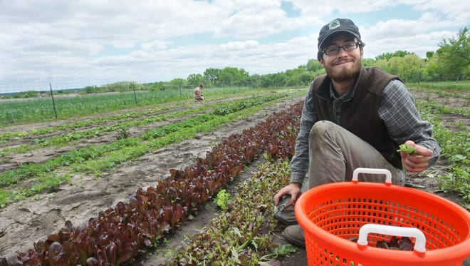 Jordan Clasen of Grade A Gardens in Johnston grows organic vegetables for farmers' markets and CSA members.