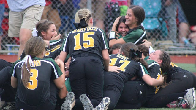 Menard softball players celebrate in a dog pile after defeating Winnfield 1-0 Saturday evening to win the Class 2A state softball championship. It's the school's third championship and first since 2001.