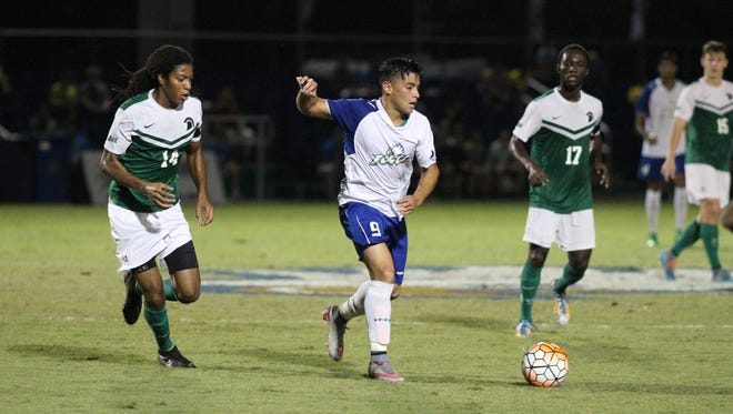 Dylan Sacramento dribbles through USC Upstate defenders during Saturday night's Atlantic Sun semifinal in Fort Myers. FGCU fell in overtime to the Spartans 4-3, ending their season.
