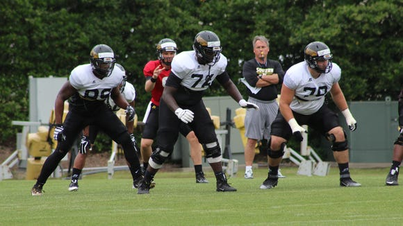 Southern Miss' Ty Pollard works at right tackle during Tuesday's practice session in Hattiesburg.