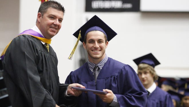 Garrhett Adkins was one of the first to receive his diploma from Principal Garry Chadwell on Friday at the Northeast High School Class of 2016 graduation ceremony.