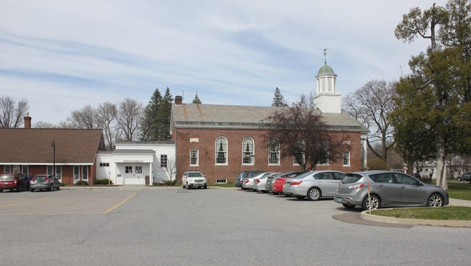 Pierson Library in Shelburne. Entrance is in the white portion; library to the left and in lower level of Historic Town Hall on right.