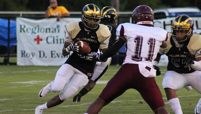 Bassfield's Kenterio Smith attempts to elude Forrest County AHS defender Deshawn McDaniel during a game.