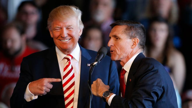 Donald Trump jokes with retired Lt. Gen. Michael Flynn as they speak at a campaign rally in Grand Junction, Colo. Oct. 18.