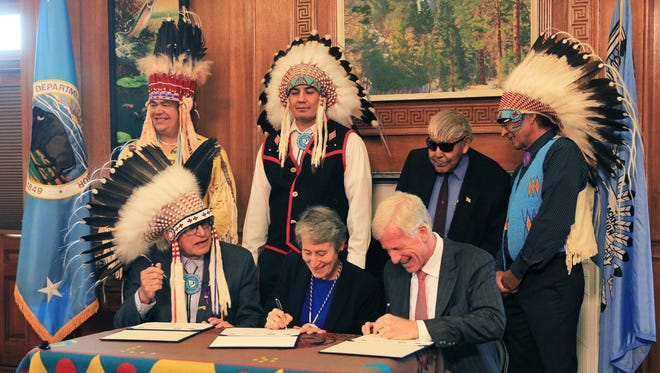 Blackfeet tribal elders look on as Interior Secretary Sally Jewell signs the cancellation of 15 of the final 17 leases of undeveloped land in the Badger-Two Medicine area on Wednesday in Washington, D.C.