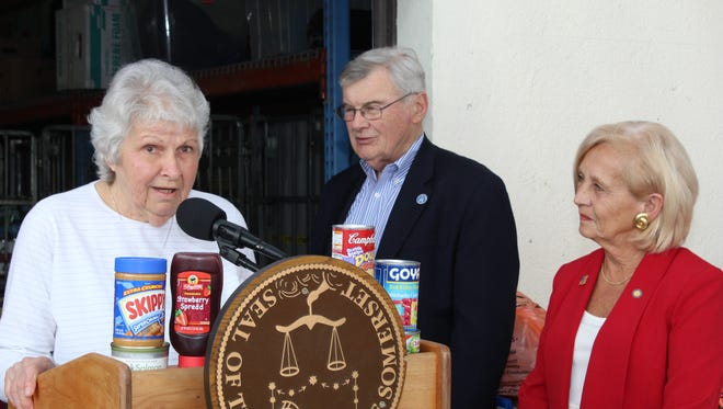 Food Bank Network of Somerset County Executive Director Marie Scannell (left) discusses the importance of the 23rd annual Curbing Hunger Month food drive. Looking on are Freeholder Director Peter S. Palmer and Freeholder Patricia Walsh.