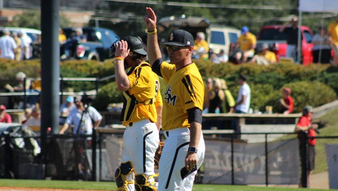 ULM confirmed on Tuesday that Southern Miss pitching coach Michael Federico (right) is its new baseball coach.