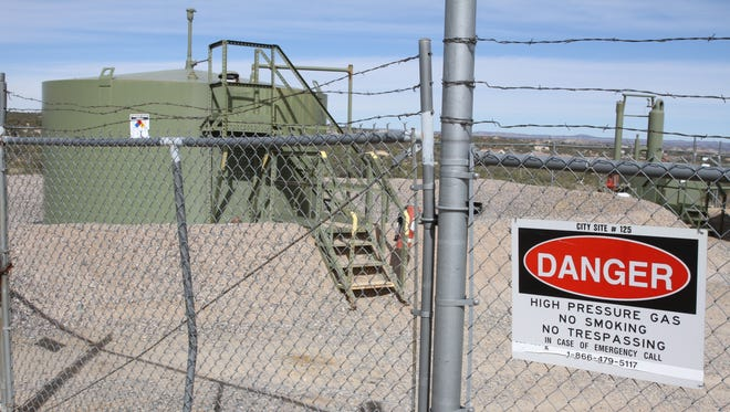 An XTO Energy natural gas well facility near Piedra Vista High School in Farmington is among the company's assets in the San Juan Basin that have been purchased by Hilcorp in a deal confirmed Wednesday.