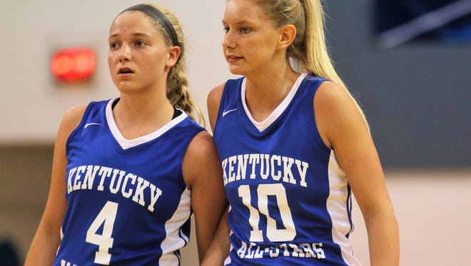 Campbell County senior Taylor Clos, 4, and Cooper senior Lexi Held wait for a restart during the Ohio-Kentucky All-Star Game April 7, 2018 at Thomas More College, Crestview Hills KY.