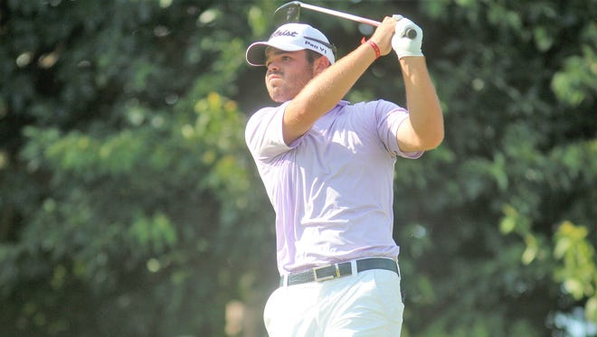 Austin Squires watches his drive during the round of 16 of the 109th Tony Blom Metropolitan Amateur Championship golf tournament June 29, 2018 at Triple Crown Country Club, Union KY.